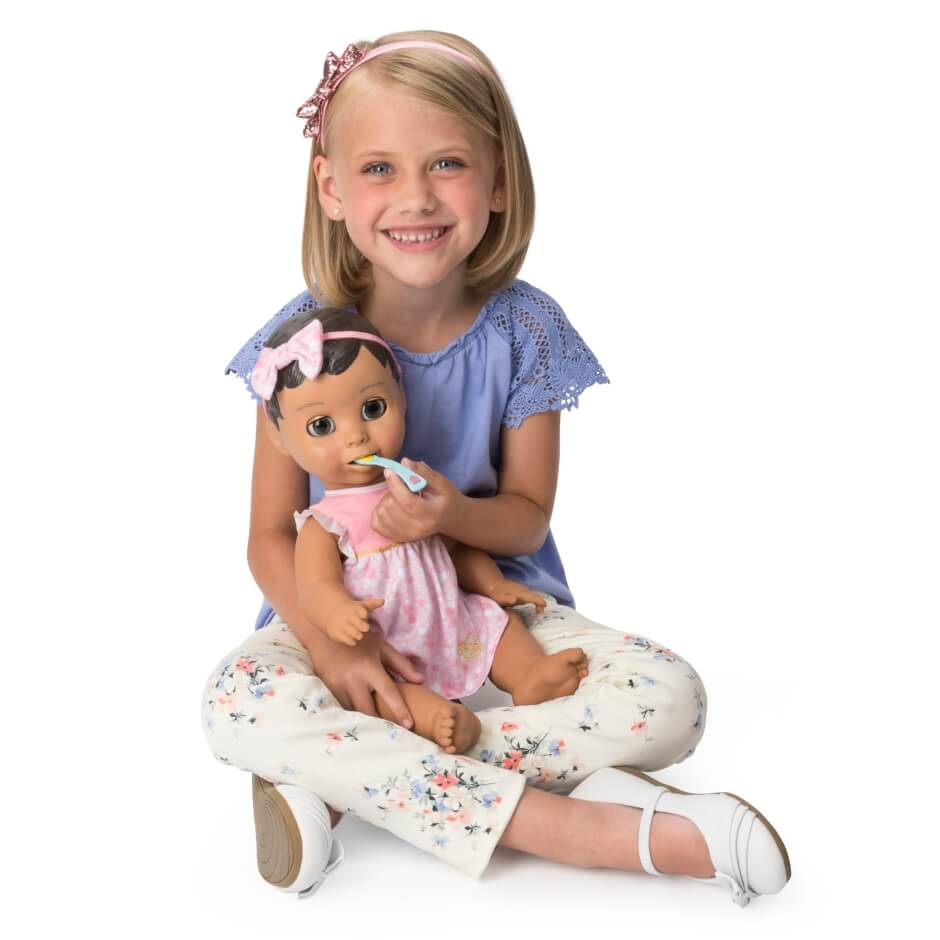 child with luvabella doll